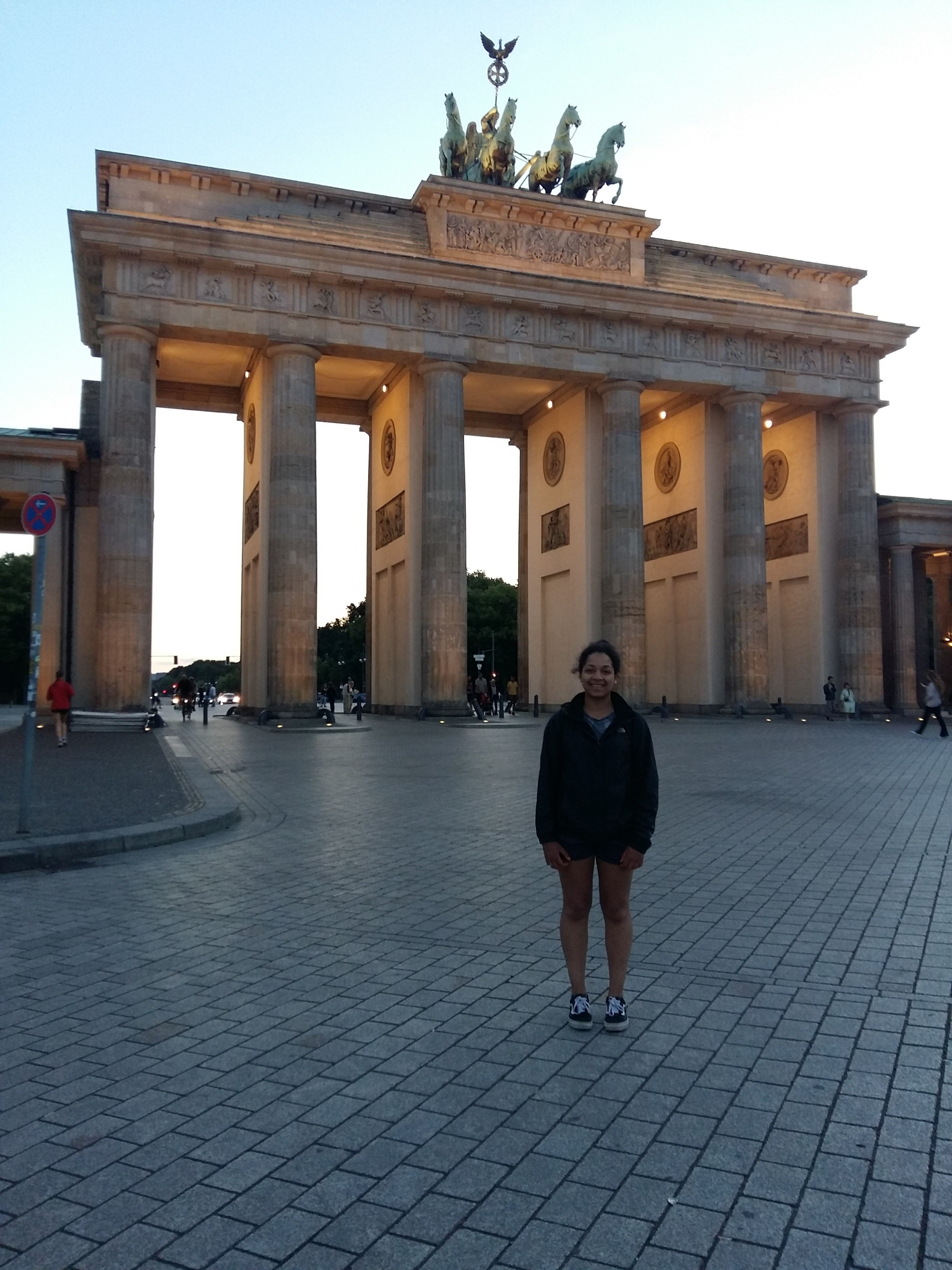 Student in front of the Brandenburg Gate in Germany