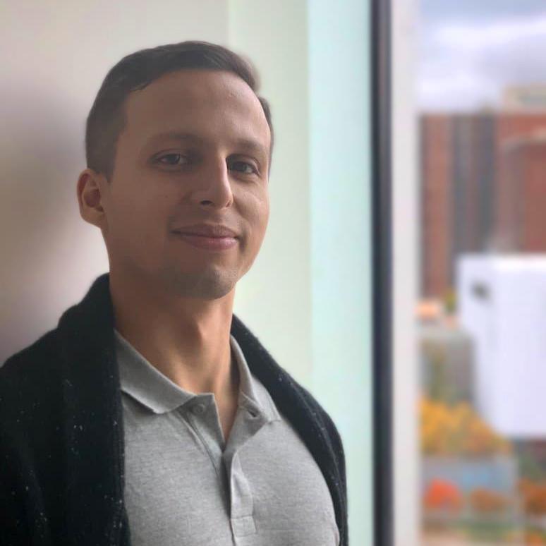 Student smiling at a camera