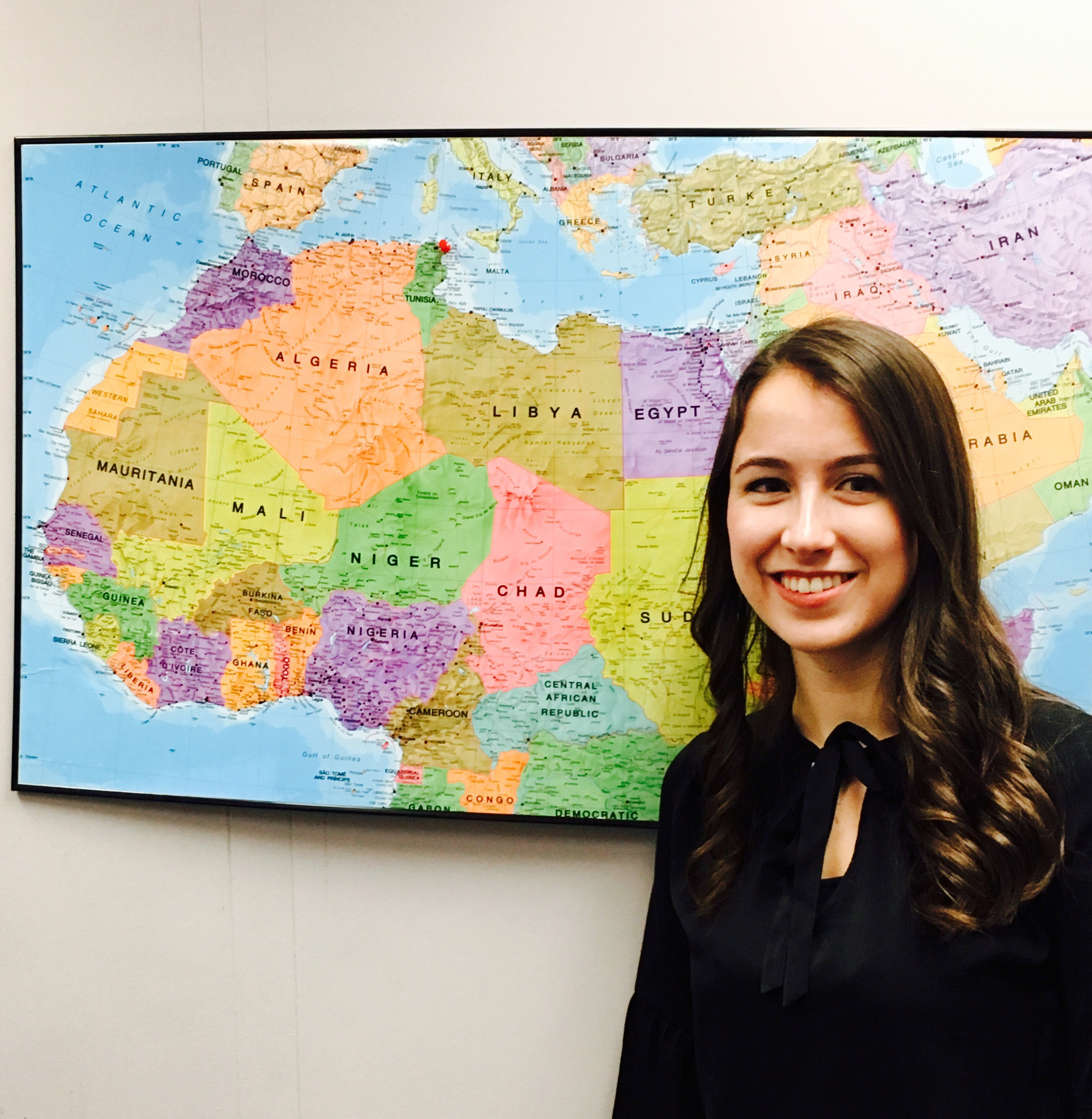Student in front of a world map