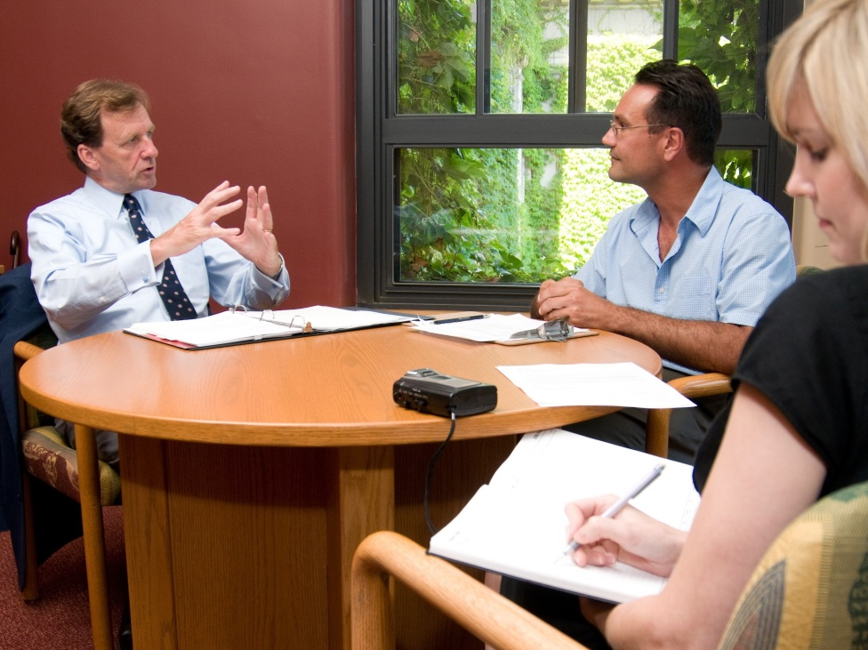 Two employers interviewing a student in a meeting room