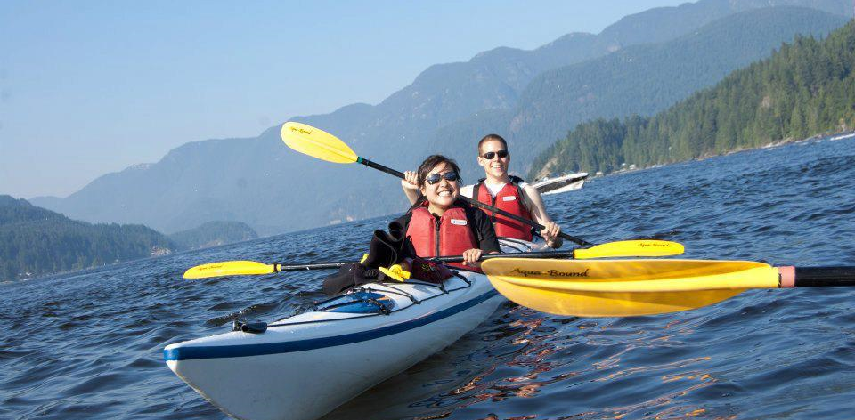 Students kayaking on a lake