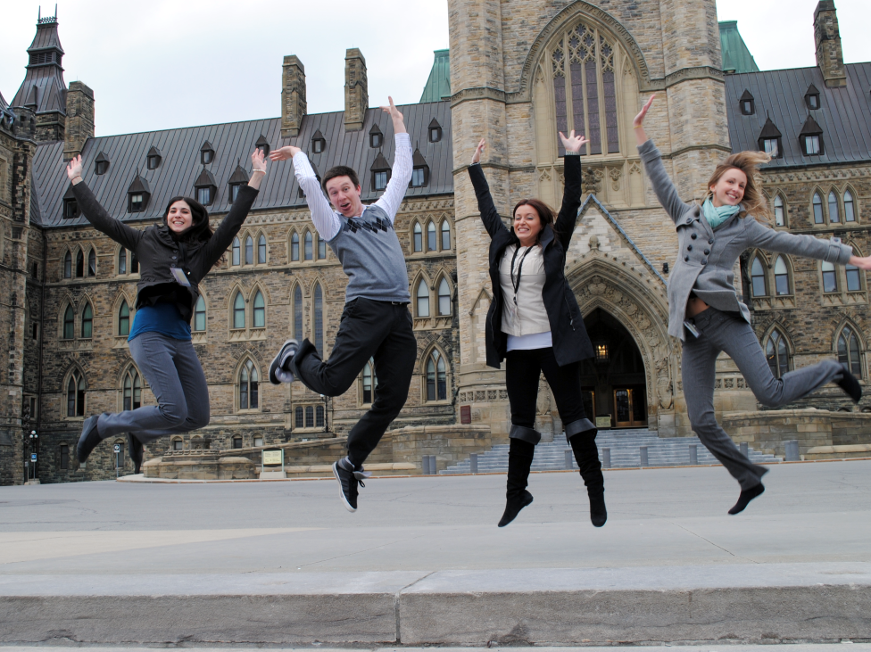 Four CO-OP students in front of the Parliement of Canada in Ottawa