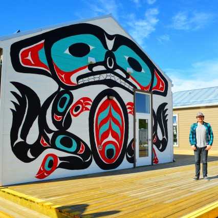 Student infront a aboridginal house in Yukon